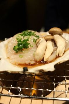 Photo: Grilling Japanese Giant Hotate Scallop and Shimeji Mushrooms on a Shell|ホタテとしめじの網焼き