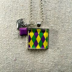 Mardi Gras inspired Glass Pendant Necklace with Charms by What The Buckle on etsy.com