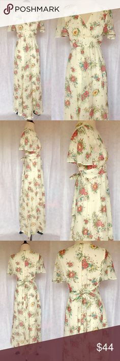 "Vtg 70s S Sheer Floral Angel Aline Boho Maxi Dress This vintage dress is perfect for a festival! Features deep ""V"" crossover bust, angel sleeves, fitted waist, waist ties, aline style, and maxi length. Has sheer floral print in pink, blue, green, and yellow against an ivory background. Dress (minus sleeves) is fully lined. Zips down back & hooks at neck. Has pink stain; Price reflected  Brand: N/A Material: N/A Size: N/A (Fits like a Small) Bust: 34-37 Waist: 26-27 Hips: 44-46 Neck Drop: 8.5…"