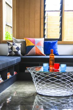 Modern design, but still playful and fun! Love the vibrant colors against the greys
