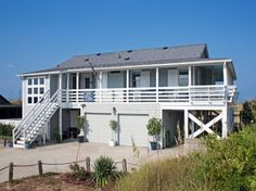 This classic Outer Banks Oceanfront vacation home in Nags Head, with its wonderful combination of
