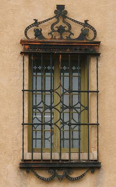 Window with decorative security bars, Santa Fe, New Mexico by cocoi_m, via Flickr