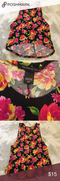 Bright floral tank top Bright floral muscle tank top. Size small. High low hem. No defects. Black is slightly faded from normal wash & wear. From a smoke free home. OFFERS WELCOME PINK Victoria's Secret Tops Tank Tops