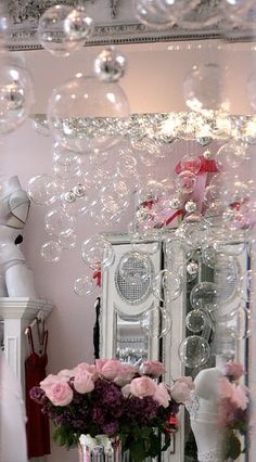 Bubble chandelier tutorial.  This looks so whimsical.  could do this with a large picture frame or screen door and chicken wire.