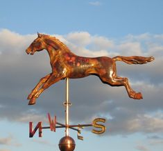 Custom repousse copper weathervane. This running horse weathervane includes a spun copper ball with it's cardinal letters.