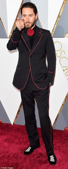 Unique look: Jared Leto, 44, eschewed the traditional tuxedo in favor of a black-and-red suit that very closely resembled the kind of ensemble worn by a flamenco dancer. He finished the look off with a pair of slippers that were each decorated with a picture of a snake
