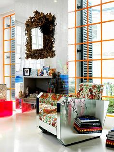 Matthew Williamson's home...yes, that's a mirrored lounge chair.