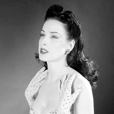 Dita von Teese - hair inspirartion - www.squidoo.com/how-to-do-victory-rolls-pinup-hair