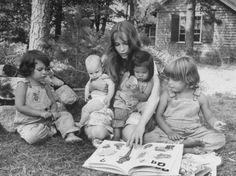 Actress Mia Farrow Reading to Her Adoptive Vietnamese Daughter Lark and Others Outside at Home by Alfred Eisenstaedt