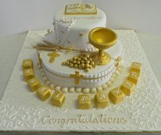 White and gold two tier confirmation cake.