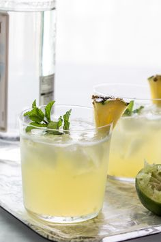 Pineapple Mojito  1/2 cup pineapple, finely chopped  10 mint leaves  2 teaspoons sugar (or more depending on the sweetness of the pineapple)  4 ounces white rum  juice from 1/2 lime  club soda for serving  wedges of pineapple and mint leaves for garnish