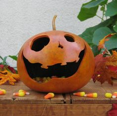Jack-O-Lantern Gourd Halloween Orange Carved Pumpkin Trick or Treat Natural Candy Bowl. $26.00, via Etsy.