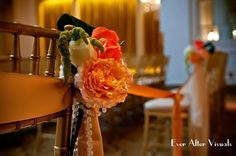 Clustered florals of orange, cream and peach garden roses with gold sashes and pearls