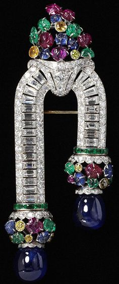 Gasp!......Platinum and gold set with baguette and brilliant-cut yellow diamonds, emeralds, sapphires, and rubies, circa 1930   tooty fruitty!
