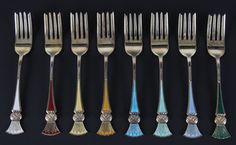 8 kakegafler i forgylt sølv og emalje, J. Tostrup. (L:13cm)