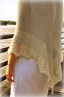 River Walk was inspired by the beautiful boardwalk in downtown Wilmington, along the Cape Fear River. Boardwalks have a minimalist feel, and so doe River Walk. The shawl is knit in garter stitch, with an understated striped section, and a delicate yet simple lace edge. The yarn used in the shawl, Berroco's Summer Silk, is perfect for summer, is incredibly soft, as light as air, and has perfect drape after blocking.