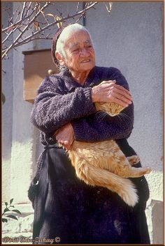 An old lady holding her cat