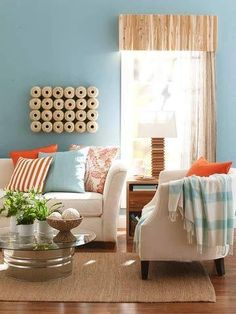 Create a valance, lamp, wall art, plant holders and coffee table from inexpensive materials.
