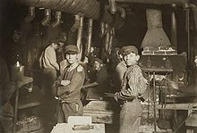 September 26, 1874: Born, Lewis Hine. American photographer Lewis Hine used his camera as a tool for social reform, and especially concentrating on the abuses of child labor. His photographs were instrumental in bringing attention to these issues. Shown is a photograph of child laborers in a glassworks factory in Indiana.