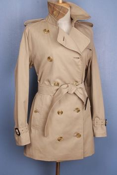 Beautiful vintage Burberry trench coat, refurbished to a modern look, size M/L $249 This is a 100% genuine Burberry Trench Coat, customized by our master tailor to a Modern Short Trench Coat. Including the Burberry check to the back on the collar which looks fantastic when collar is turned up. More vintage Burberry coats in variable sizes and colors available in our shop. Use code Pinterest10 for a 10% discount on this coat at check out.