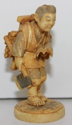 "Fine Japanese Carved Ivory Netsuke. Finely carved wood carrier. Signed on bottom. Measures - 2 3/8"" high"
