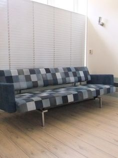 Martin Visser couch.  Upholstered with a patchwork of used denim ( jeans, jackets & skirts from the whole family ! )