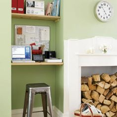 Fantastic work space created in fireplace alcove. Living room office features green walls and floating desk with shelving using plank boards. Fireplace with floating desk and Tole Stool. Tiny Home Office, Small Home Offices, Small Space Office, Home Office Storage, Home Office Space, Home Office Design, Home Interior Design, Office Spaces, Work Spaces