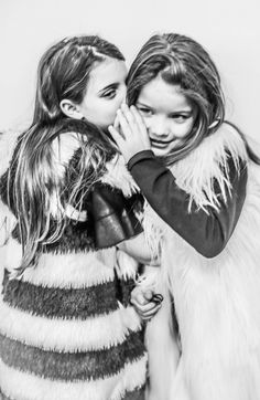 Two girls modelling around the Pitti Bimbo  trade fair dressed in the clothes of Jijil  fall 15 collection