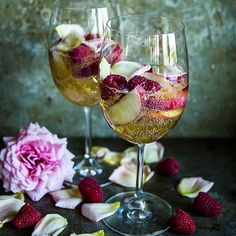 White Peach Sangria With Raspberries And Rose Petals