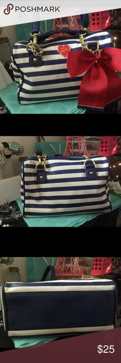 Betsey Johnson Stripes Handbag Excellent excellent condition no flaws at all used once because it's too small. Betsey Johnson Bags Satchels