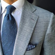 Tap into refined, elegant style with a grey blazer and a white dress shirt. Shop this look on Lookastic: https://lookastic.com/men/looks/grey-blazer-white-dress-shirt-blue-tie/20940 — White Dress Shirt — Blue Tie — Grey Blazer — Navy Print Pocket Square