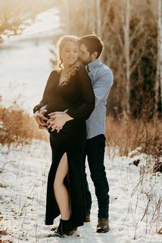 Winter couple photo ideas. This stunning velvet maternity maxi dress was the best maternity outfit for their winter maternity photoshoot. #SexyMamaMaternity #SexyMama #wintermaternityshoot