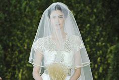 Gold trim garnishes this  Carolina Herrera veil with subtle sparkle for a shimmering update on a classic look.