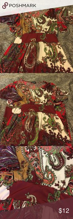 Bright paisley print spring/summer dress. V-neck short drape sleeve dress with a bright paisley print. Knee length. Full colors contained in pattern are red, burgundy, bright green, white, purple, coral, pink, and light brown. This dress was a gift. Studio West Dresses Midi