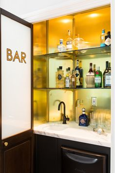 """A friend came over the other night and saw the house and said, 'Wow, this is like the coolest hotel ever.' And that was exactly what Katie and I wanted to hear at the end of this process,"" says Shapiro. A stylized bar sits outside the living room for easy access."