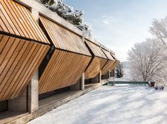 Retina House is a project designed in 2017 by Arnau estudi d'arquitectura. Located in Camí de la Doma, Santa Pau, Spain, the family house is a place where one can enjoy nature and simple things. Wooden Shutters, Window Shutters, Green Architecture, Architecture Details, Types Of Doors, Cladding, Exterior Design, Spain, House Design