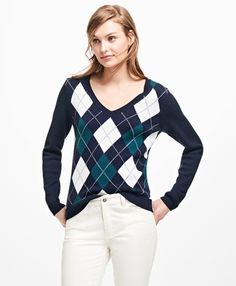 """<a href=""""#pdplearnmore"""" class=""""lm"""">The Red Fleece Collection</a><br>This elegant V-neck sweater is made from pure merino wool and has argyle on the front panel.<br><br>23""""; dry-clean only; imported."""
