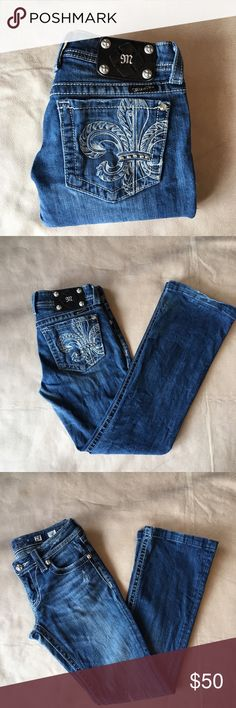 "Miss Me ""Fleur De Lis"" Bootcut Jeans Flat lay waist 15.5"", rise 7"", inseam 28.5"". GUC. Minor signs of wear on hem and a small discoloring as shown in the last picture. A great pair of denim to add to your closet! Miss Me Jeans Boot Cut"