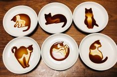In Japan, these photos of soy sauce cat art have gone going viral. The secret: special ceramic dishes, produced by a Japanese manufacturer called Artha. If you're in Japan, you can pick up a set from the cat-themed Art Shop Nekomachi in Kamakura. Flea Shampoo For Cats, Cats And Cucumbers, Cappuccino Machine, Cat Drinking, Cat Cafe, Italian Coffee, Fancy, Ceramic Design, Latte Art