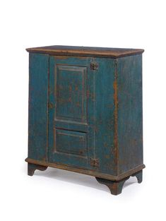 A DIMINUTIVE QUEEN ANNE BLUE-PAINTED CUPBOARD  Hudson River Valley, New York, 18th century  The backboards with painted inscription: ..rles War.. [possibly Charles Warner] New Berlin Chenango C..[ounty] N.Y. 42½ in. high, 36¾ in. wide, 16¾ in. deep