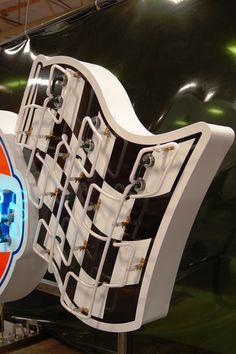 From the VAULT® Collector Series. Hand-crafted recreation of a classic #GulfRacing porcelain and enamel neon sign. VaultGarage.com  . . . .  #garagecabinets #garageremodel #ultimategarage #craftsmanship #dreamgarage #mancave #MadeinUSA #garageluxury #customgarage #goodlife #garage #garagelife #garagelifestyle #handmade #garagelove #garagemakeover #homedesign #garagedesign #garagedecor #homedecor #sportscars #classiccars #cars