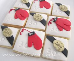 UFC themed cookies by L sweets, via Flickr-- awesome except the gloves need to be MMA open-finger gloves- instead of boxing gloves.