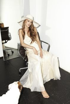 Chanelling studio 54 and boho glamour with a wide brimmed floppy hat and dress from Houghton NYC.