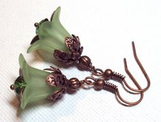 Earrings Green Peridot Frosted Lucite Lily Flower Antique Copper Czech Glass Faceted Bead FREE SHIPPING. $6.95, via Etsy.