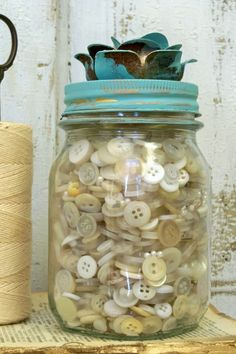 Recycled mason jar full of white buttons