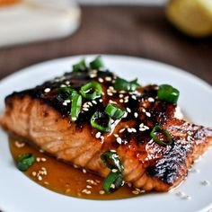 Toasted Sesame Ginger Salmon Recipe Main Dishes with salmon, olive oil, toasted sesame oil, rice vinegar, brown sugar, soy sauce, garlic cloves, ginger, toasted sesame seeds, green onions, honey, toasted sesame oil, soy sauce, ginger, toasted sesame seeds