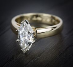 This stunning Marquis Cut Diamond Cathedral Solitaire Engagement Ring in Yellow Gold is off to one soon to be very happy individual!
