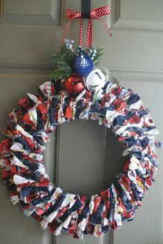 Fabric Wreath. Definitely took alot longer than i thought it would tying all the fabric on there.