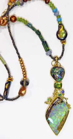Boulder Opal (opalized wood) pendant with peridot, tsavorite, tanzanite in 22k and 18k gold; on a very eclectic beaded piece.... pearl, diamond, smokey quartz, turquoise, peridot and more.  by Jennifer Kalled, Opals from Bill Kasso.