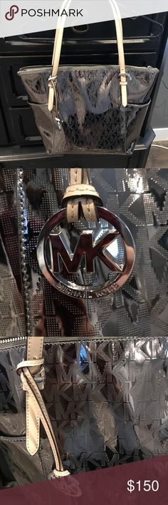 Brand new never used Micheal Kors purse. Brand new never used Micheal Kors purse. No tags. Perfect condition. Silver patent. No trades. Michael Kors Bags Totes